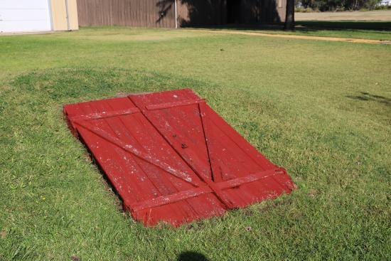 Oz Tornado Shelters : Tornado shelter picture of dorothy s house land oz