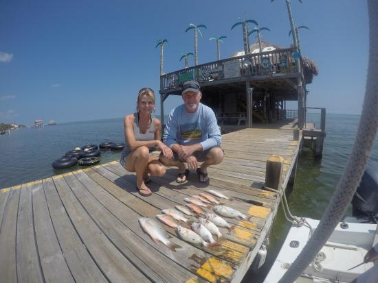 Lines out picture of belize fishing charters san for Fishing san pedro belize