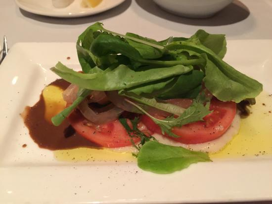 Roy's Waikiki Beach: salad (2nd) course: greens & tomato on hearts of palm puree