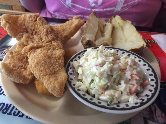 Pauls Valley, OK: Two piece catfish platter with slaw, baked potato, and hush puppies.