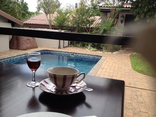 At Heritage House: tea and sherry on the veranda overlooking the pool