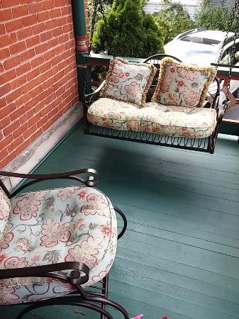 Bay City, MI: Rattan swing on back porch