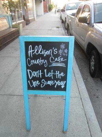 Allison's Country Cafe: sign on sidewalk