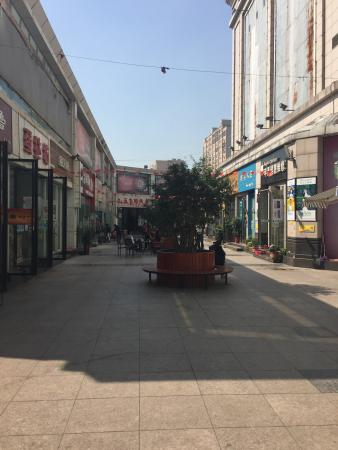 Xiangyang, China: Laodong street is a small trendy side street near to the people's park, lots of small clothes sh