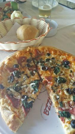 Martelli: Pizza with local sausage, olives and spinach