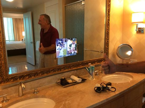 Trump International Hotel Las Vegas: TV embedded in bathroom mirror