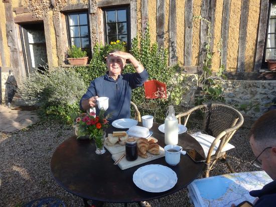 Calvados, Francia: My father enjoying Sunday breakfast!