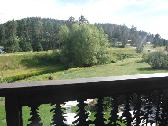 Pine Rest Cabins : View of Spring Creek and Mickelson Trail from back balcony at  Alice's Cottage in Hill City
