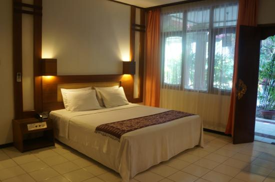 Puri Naga Seaside Cottages: Have a good night's sleep in our spacious Deluxe room.