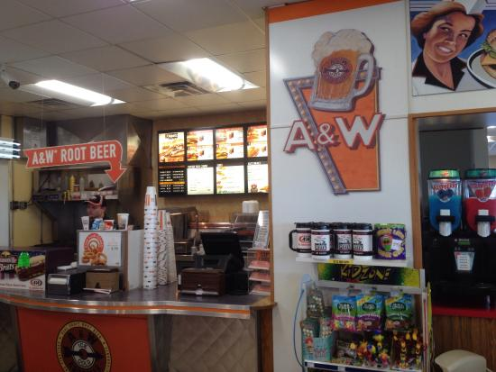 A&W Restaurant: A&W and Godfathers right inside the fuel station. Areas on edge of lot to walk dogs.