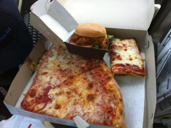 Colosseo: this is heaven a couple regular slices, a sicilian slice and a chic-fil-a from accross the stree