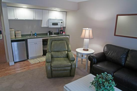 Charlevoix Inn & Suites: King Suite with Lake View Pet Friendly Living Area and Kitchenette