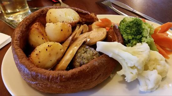 Mountbatten Pub: Giant Yorkshire Pudding with roast chicken, roast potatoes, stuffing, vegetables and gravy.