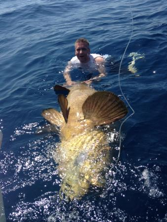 Another Keeper Charters: Me with a grouper bigger than me.