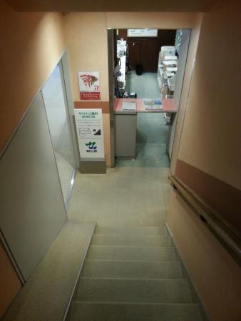 Wellbe Sakae : カプセルホテル側のチェックインカウンター