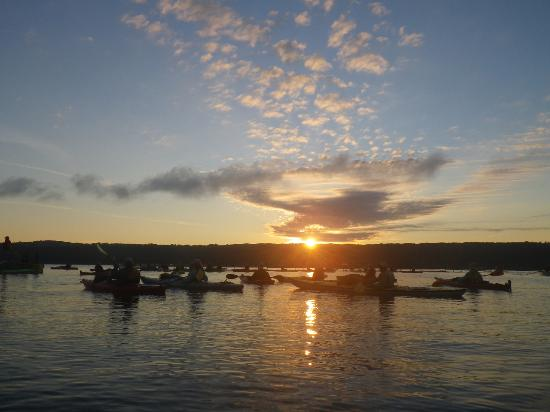 Kayaks under the rising sun on Cayuga Lake - Picture of ...