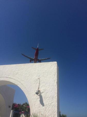 Thalassa Sea Side Resort & Suites: Plane over head
