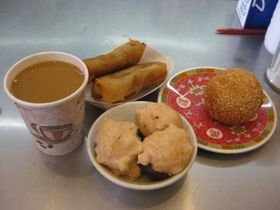 Hop Shing: Three dim sum plates with coffee at the counter