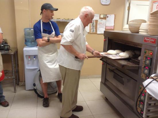 Morton's Bakehouse: Mort demonstrates loading breads into the oven