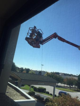 Courtyard High Point: Cherry picker with men after it had left my window!