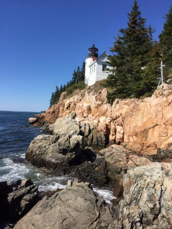 Bass Harbor Head Lighthouse view from path to the left of the parking lot.