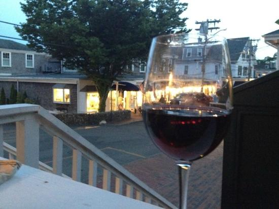 Chesca's Restaurant: Pre-dinner glass of wine on the deck at Chesca's, overlooking Water Street at dusk