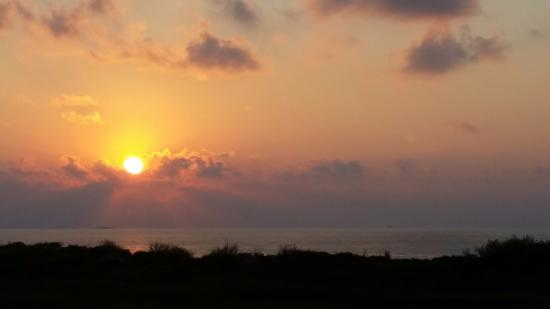 Island Retreat: Sunrise over the Gulf of Mexico as seen from my balcony.