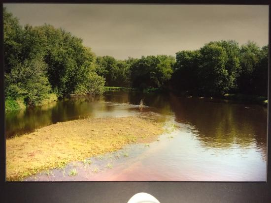Holmen, WI: framed photo of muddy creek that adorned the wall above the bed
