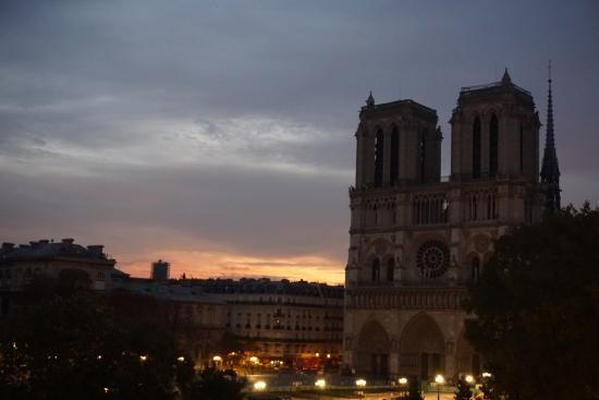 dawn behind notre dame from the room picture of hotel le. Black Bedroom Furniture Sets. Home Design Ideas