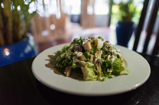 Tambua Sands: Caeser Salad Tambua Style with a soft runny poached egg and Tambua Dressing..