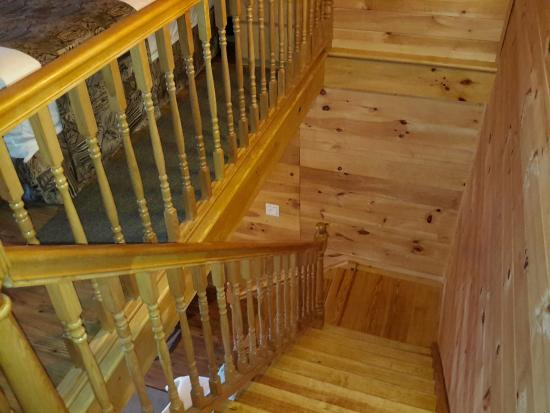 Motel Long Lake and Cottages: Stairs to the bedroom, showing the beautiful wood paneling that extends through the whole cabin