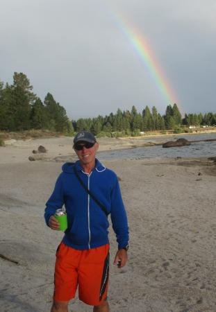 David on beach with rainbow in background, Crown Point, Cascade St. Park, Idaho