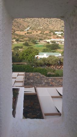 Elounda Peninsula All Suite Hotel: View through the balcony wall