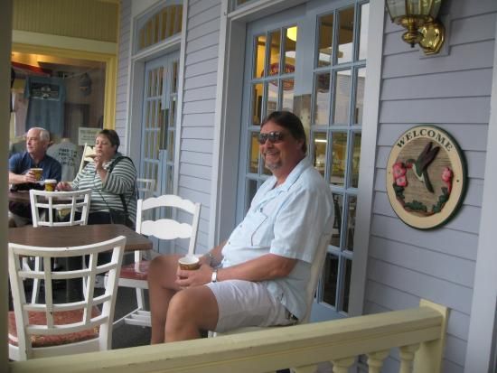 Murray Hotel: Husband Relaxing on front porch At Murray!!