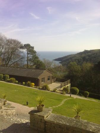 Kingswear, UK: The pool building and sea viewed from the main building