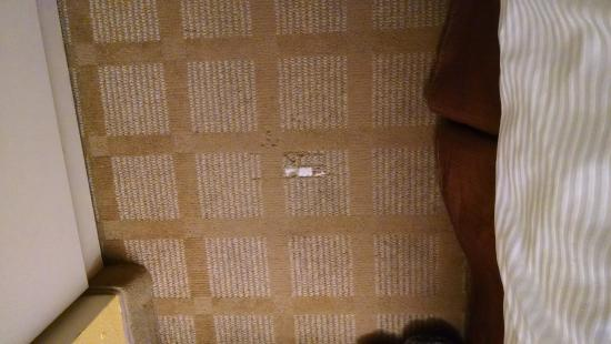 Microtel Inn & Suites by Wyndham Nashville: Hole in carpet near the bed