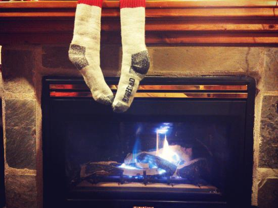 heating the socks by the in room fireplace hehe - Picture of The
