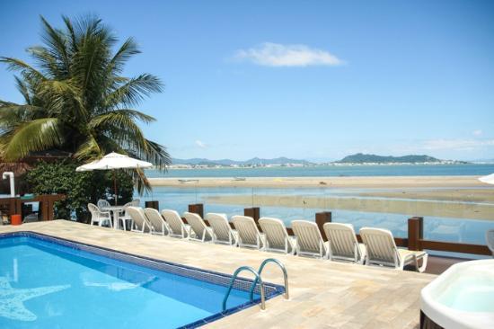Costa Norte Ponta Das Canas Hotel Florianopolis: vista mar e praia da piscina externa