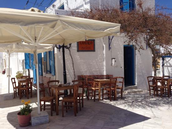 Lovely cafe in front of church in village of Lefkes - Paros, Greece