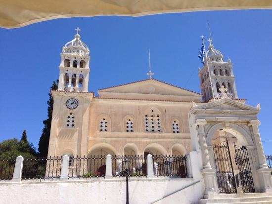 View of church from cafe across the street in village of Lefkes - Paros, Greece