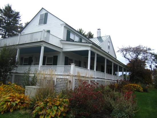 Shaker Hill Bed and Breakfast: ample side porch with rocking chairs