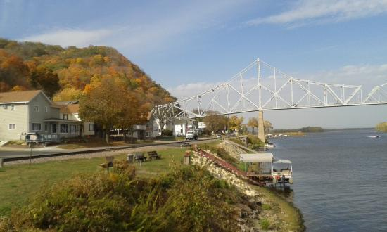 Lansing, IA: Mountain view from river shore and bridge -