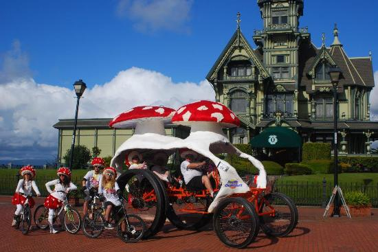 A team in the annual Kinetic Sculpture Race passes by the Carson Mansion in Eureka. Richard Sten