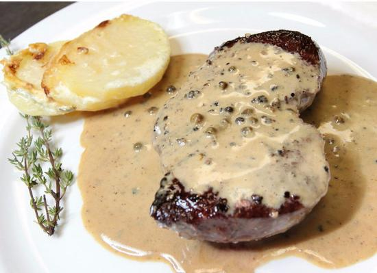 La Porte Verte: Steak au Poivre Eye fillet steak cooked in a pepper brandy sauce.