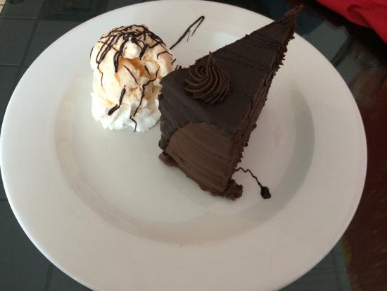 Papagallo Restaurant: Extreme chocolate dessert cake with scoop of ice cream and whip cream