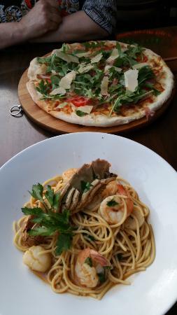 Mains, La Roma signature pizza on top.