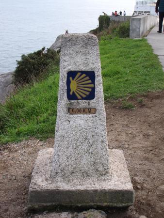 "Faro de Fisterra: Kilometer Marker ""O"" on the Camino de Santiago"