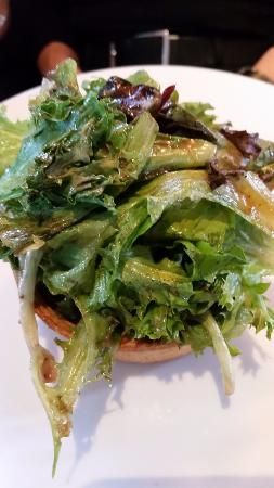 The Tavern: Quiche with greens atop.
