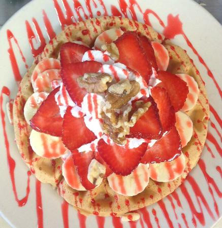 Turtle Cafe: Waffle with fresh strawberries, walnut, cream and drizzled with rose syrup!