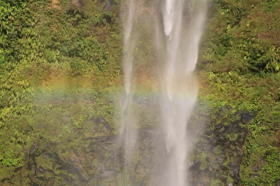 "Jasaan, Philippines: ""Hidden Waterfall"" of Sagpulon Falls rainbow only in the afternoon."